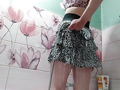 young girl in a wet skirt in the...