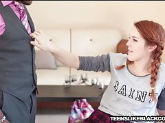Petite redhead stretched with...