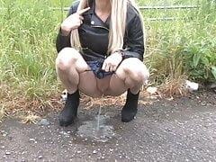 Girl Pissing At Roadside.