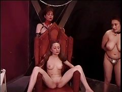 Slutty redhead is tortured by...