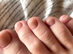 Toes with beige pedicure