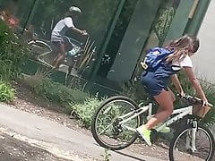 Young College girl riding bike