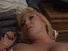 Lesbian cougar in action with a...