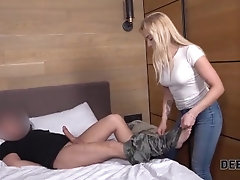 DEBT4k. Long-haired blonde with...